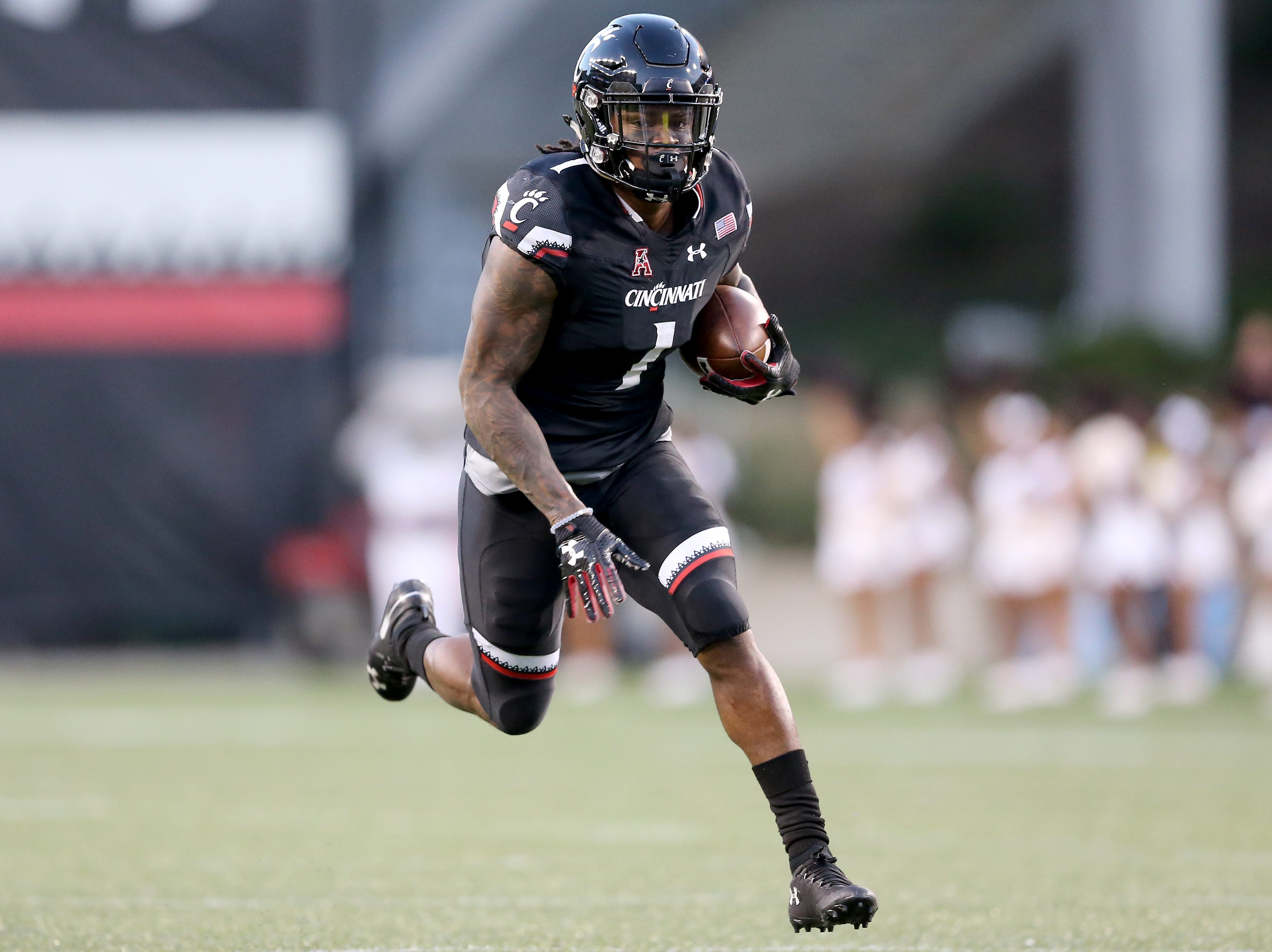 Cincinnati Bearcats wide receiver Kahlil Lewis (1) scores a touchdown in the first quarter during a college football game between the Cincinnati Bearcats and the Alabama A&M Bulldogs, Saturday, Sept. 15, 2018, at Nippert Stadium in Cincinnati.