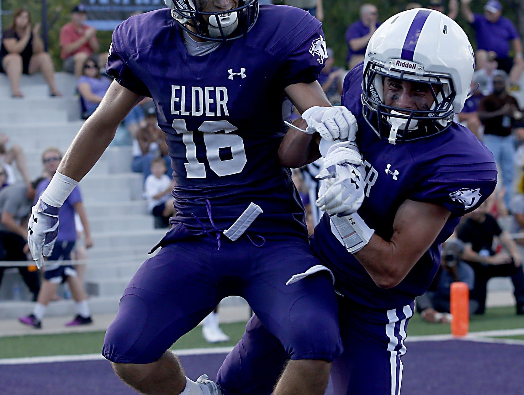 Elder's Kyle Trischler and Sean O'Conner celebrate Trischler's touchdown against St. Edward during their game at The Pit in Cincinnati Saturday, Sept. 15, 2018.