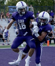 Elder's Kyle Trischler and Sean O'Conner celebrate Trischler's touchdown against St. Edward during their game at The Pit in Cincinnati Saturday, Sept. 15, 2018.