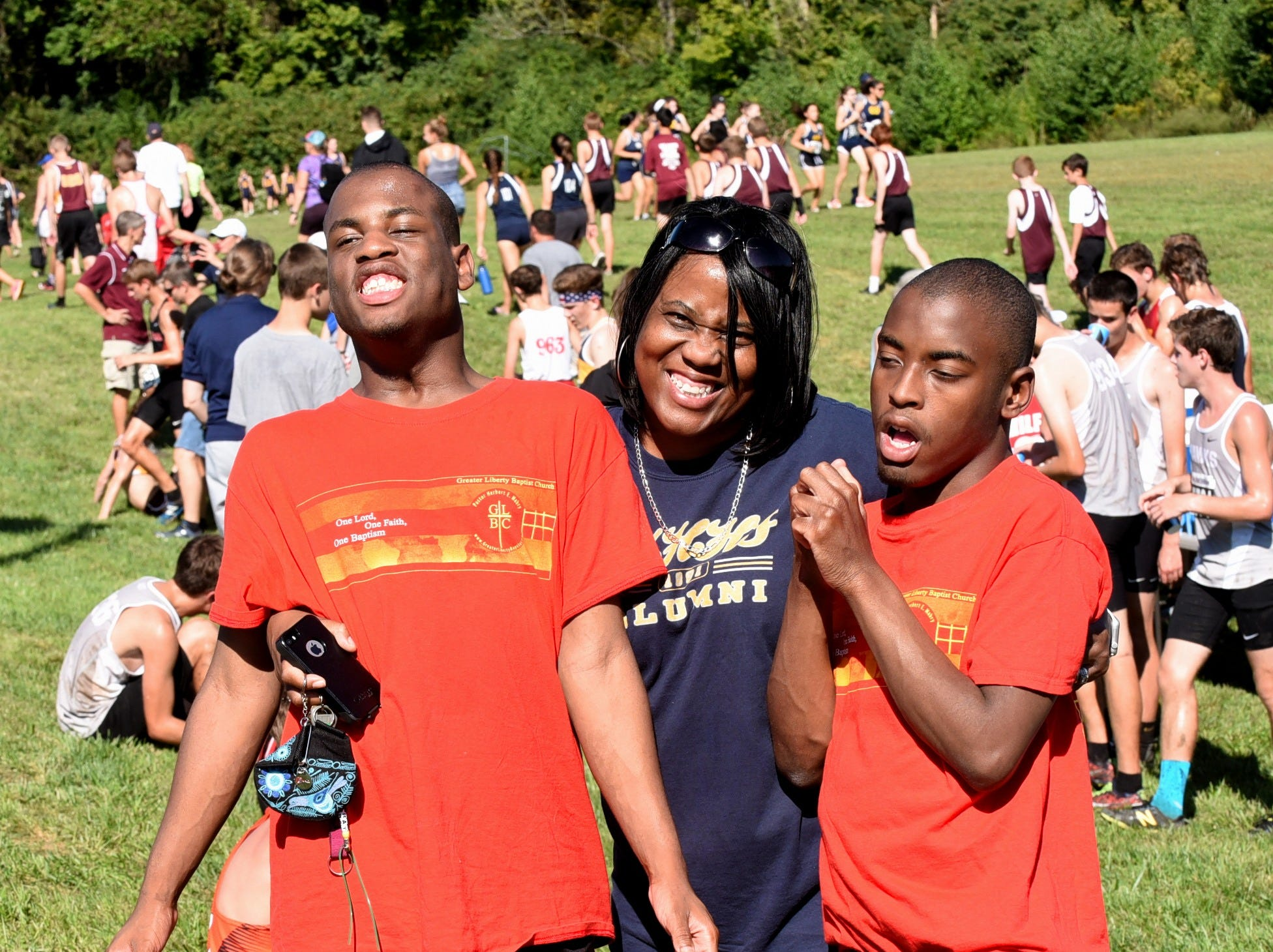 Fans from Walnut Hills celebrate their team's fifth-place finish in the boys varsity 5K race at the 2018 Milford Cross Country Invitational, Sept. 15, 2018.