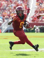 Sep 15, 2018; Ames, IA, USA; Iowa State Cyclones wide receiver Deshaunte Jones (8) catches a pass against the Oklahoma Sooners at Jack Trice Stadium.