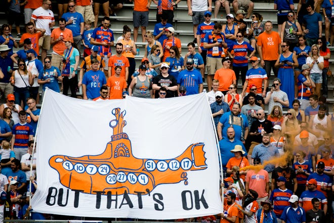 FC Cincinnati fans carry a sign with a yellow submarine before the USL match between FC Cincinnati and Toronto FC on Sunday, Sept. 16, 2018, at Nippert Stadium in Cincinnati.