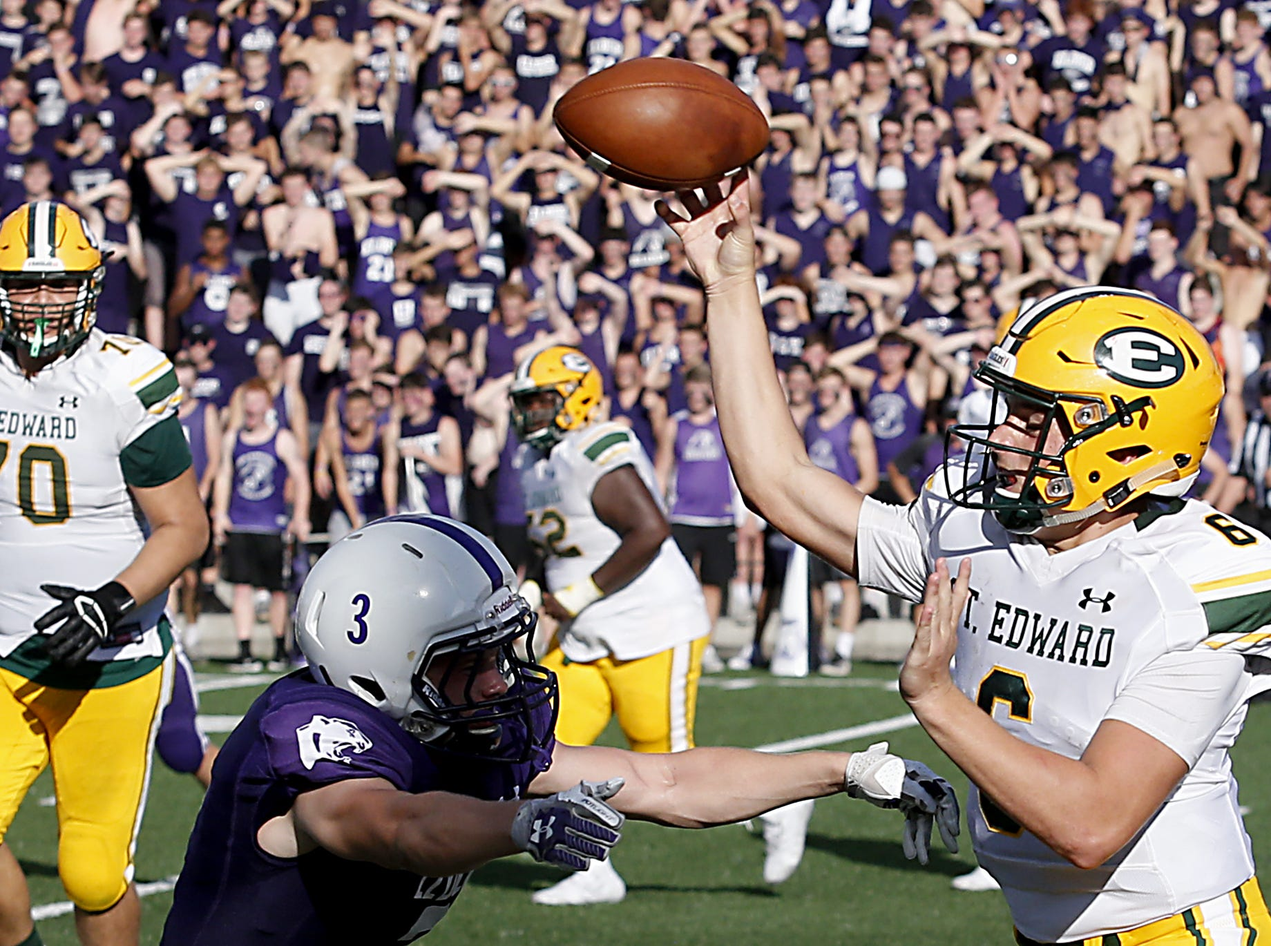 Elder defensive back Eric Beck pressures St. Edward quarterback Garrett Dzuro during their game at The Pit in Cincinnati Saturday, Sept. 15, 2018.
