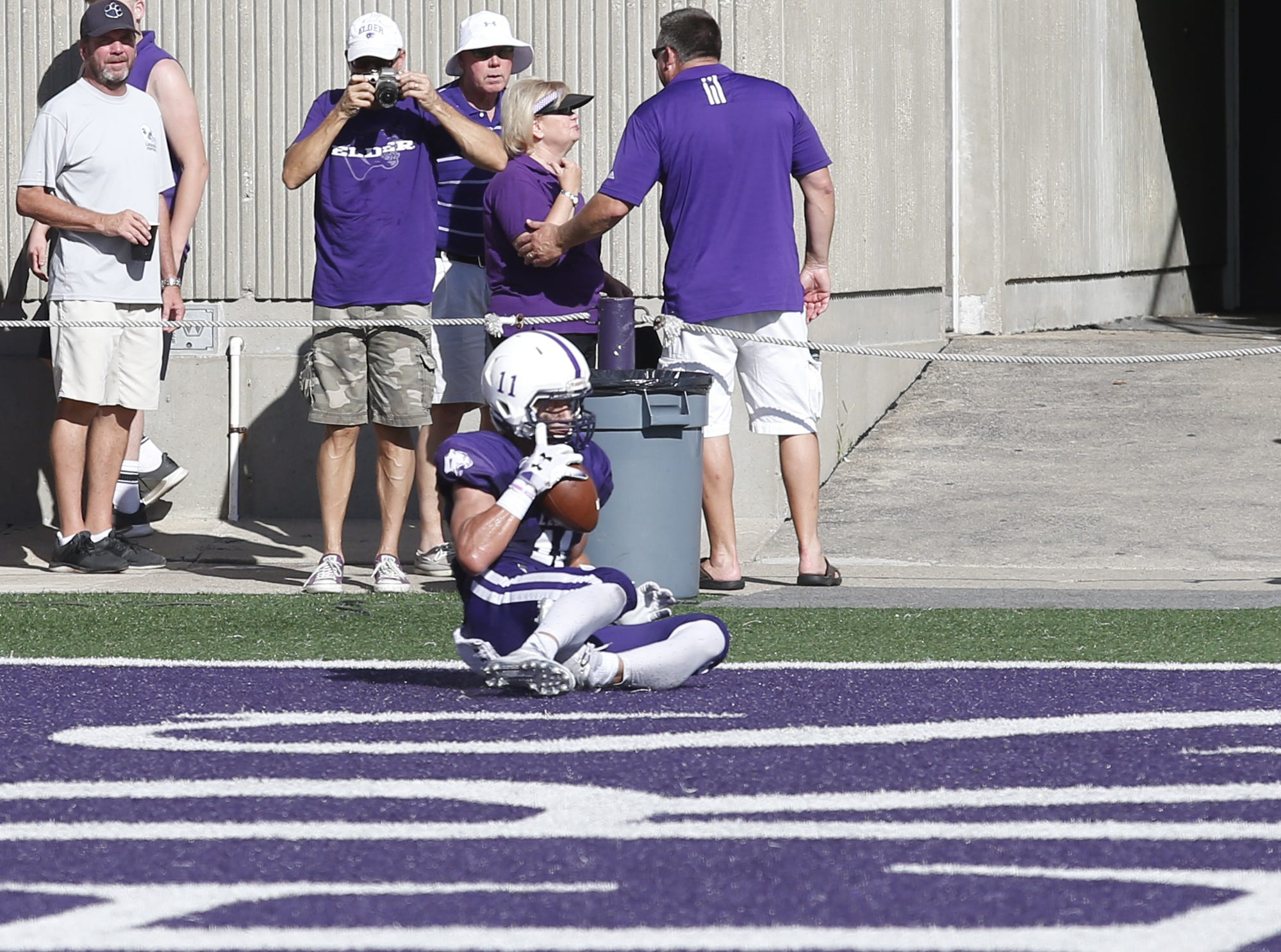 Elder tight end Joe Royer makes a reception in the end zone for a touchdown against St. Edward during their game at The Pit in Cincinnati Saturday, Sept. 15, 2018.