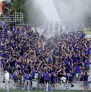 The Elder student section is doused with a hose by the fire department during their game at The Pit in Cincinnati Saturday, Sept. 15, 2018.