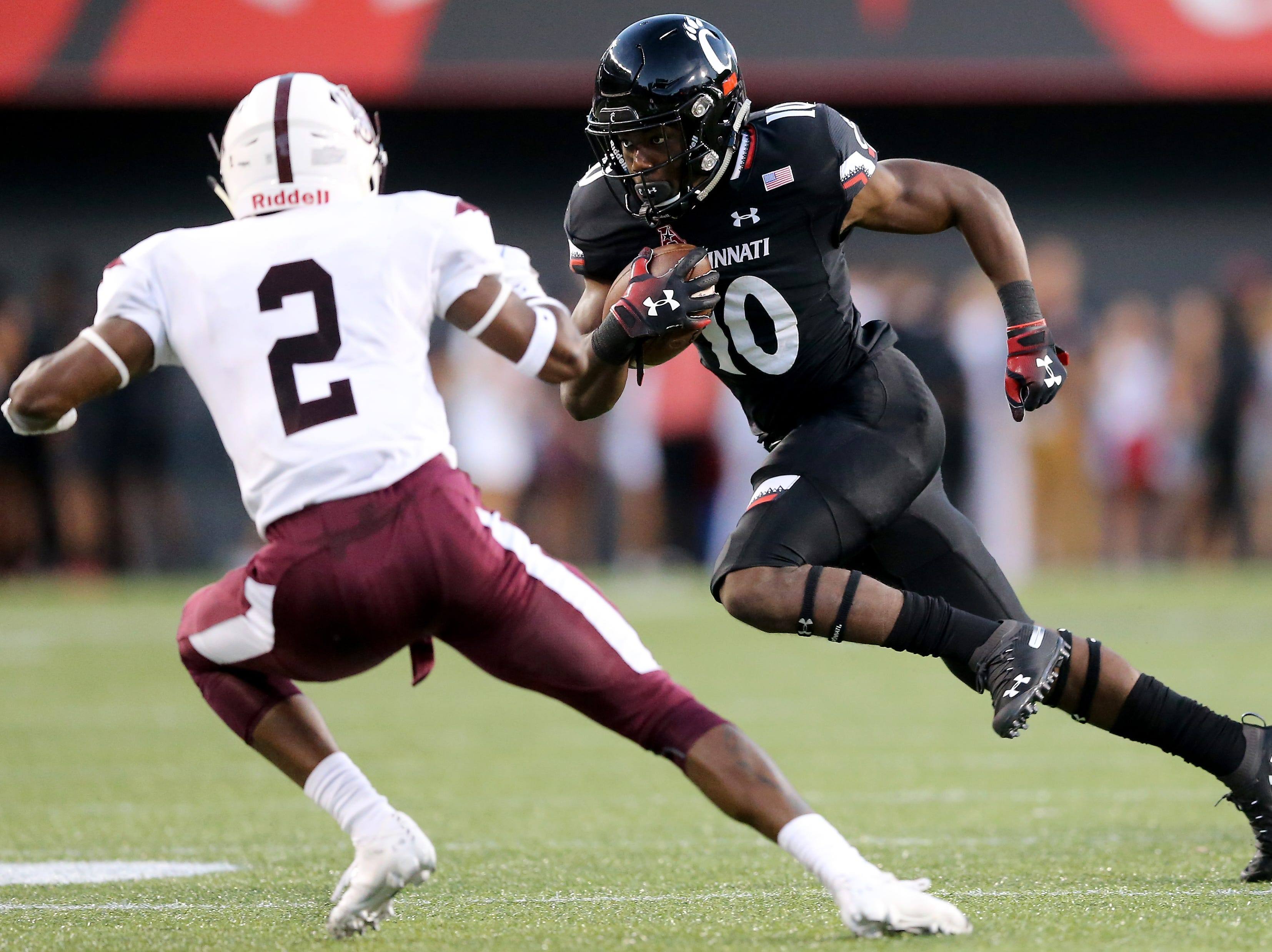 Cincinnati Bearcats running back Charles McClelland (10) carries the ball in the first quarter during a college football game between the Cincinnati Bearcats and the Alabama A&M Bulldogs, Saturday, Sept. 15, 2018, at Nippert Stadium in Cincinnati.