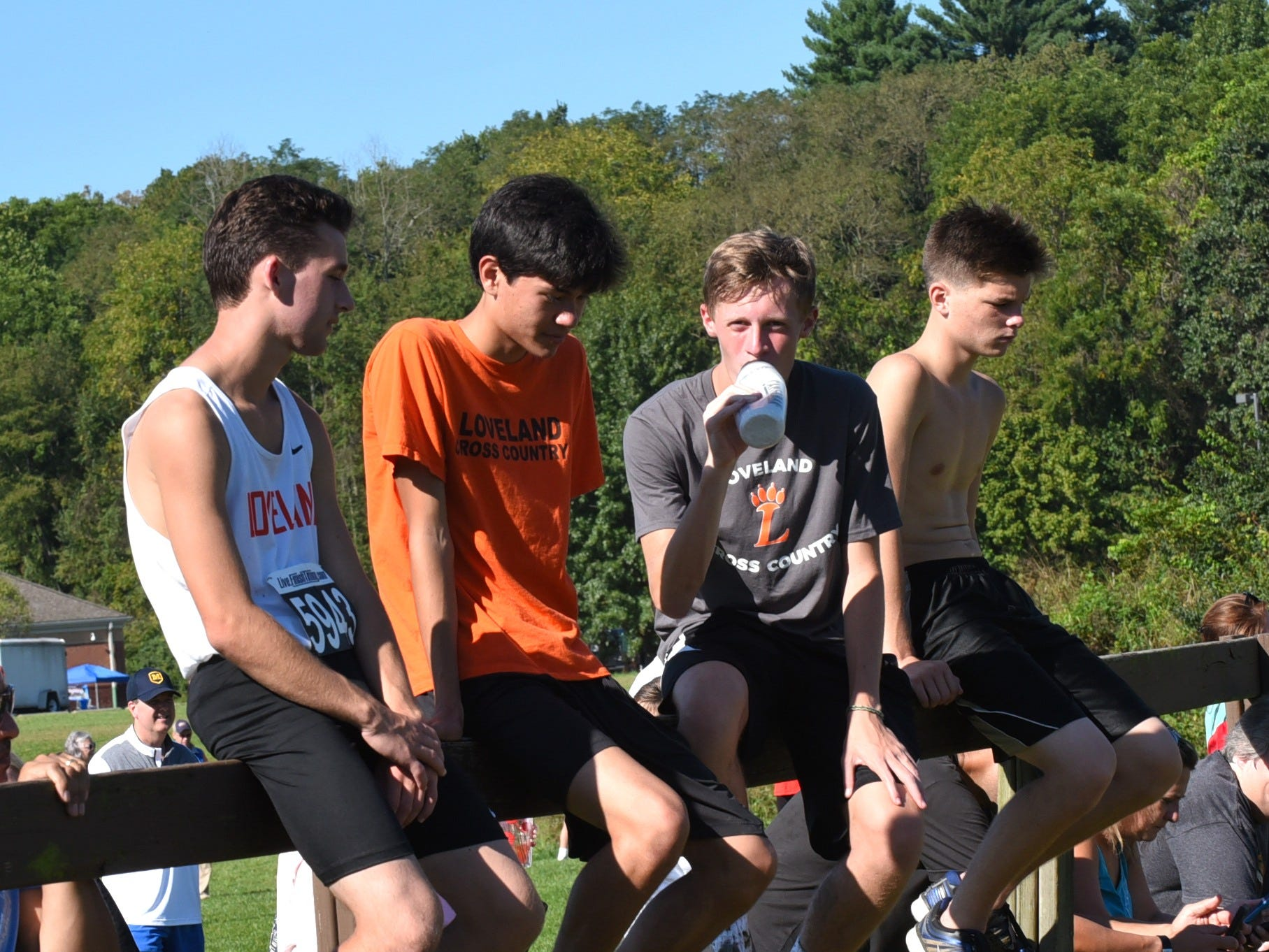 Loveland XC student supporters take to the fence to cheer for the Tigers in the boys varsity 5K race at the 2018 Milford Cross Country Invitational, Sept. 15, 2018.