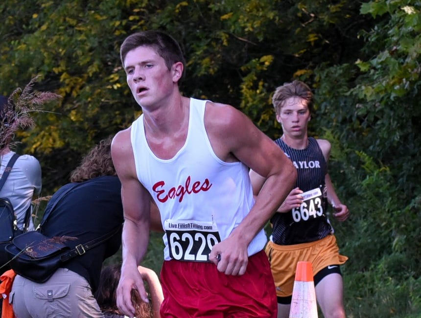 Milford's AJ Dickerson powers past the half way mark in the varsity boys 5K race at the 2018 Milford Cross Country Invitational, Sept. 15, 2018.