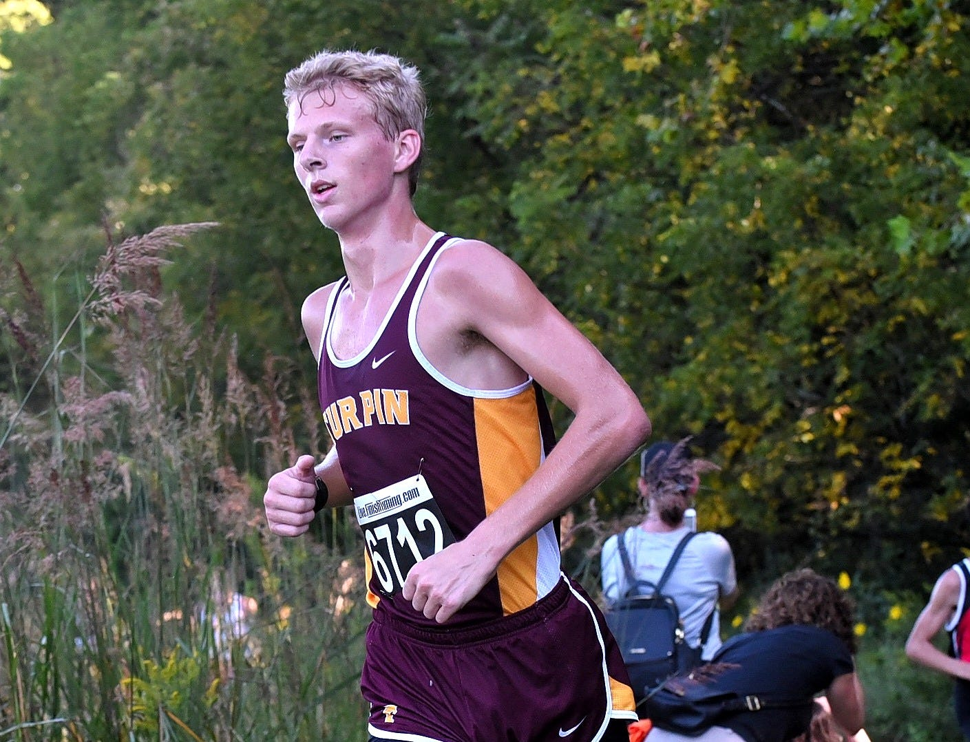 Turpin's John Morton cuts a corner while running at the 2018 Milford Cross Country Invitational, Sept. 15, 2018.