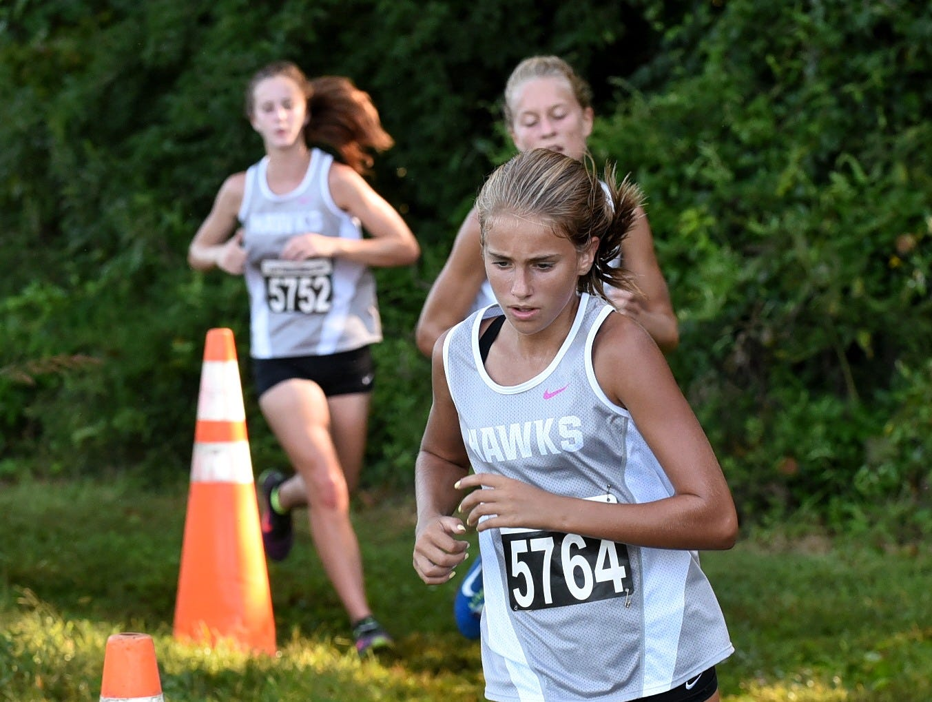 Cali Reynolds of Lakota East concentrates on the trail as she runs in the Varsity Girls 5K race at the 2018 Milford Cross Country Invitational, Sept. 15, 2018.