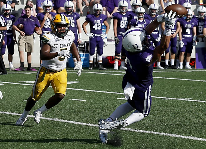 Elder tight end Joe Royer stretches out for a catch against St. Edward during their game at The Pit in Cincinnati Saturday, Sept. 15, 2018.