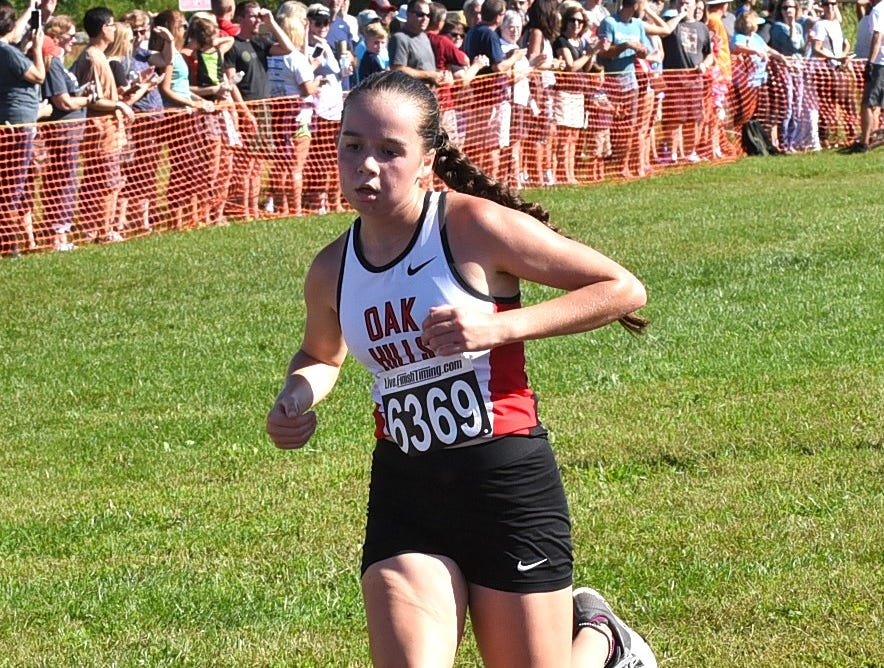 Megan John of Oak Hills wrapped up 2nd place in the Varsity Girls race at the 2018 Milford Cross Country Invitational, Sept. 15, 2018.