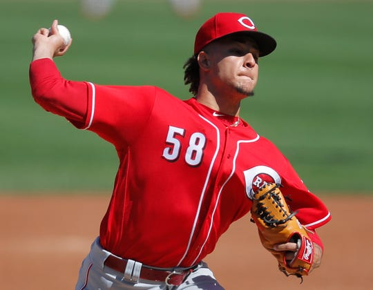 Cincinnati Reds' Luis Castillo pitches against the Chicago Cubs during the first inning of a baseball game Sunday, Sept. 16, 2018, in Chicago.