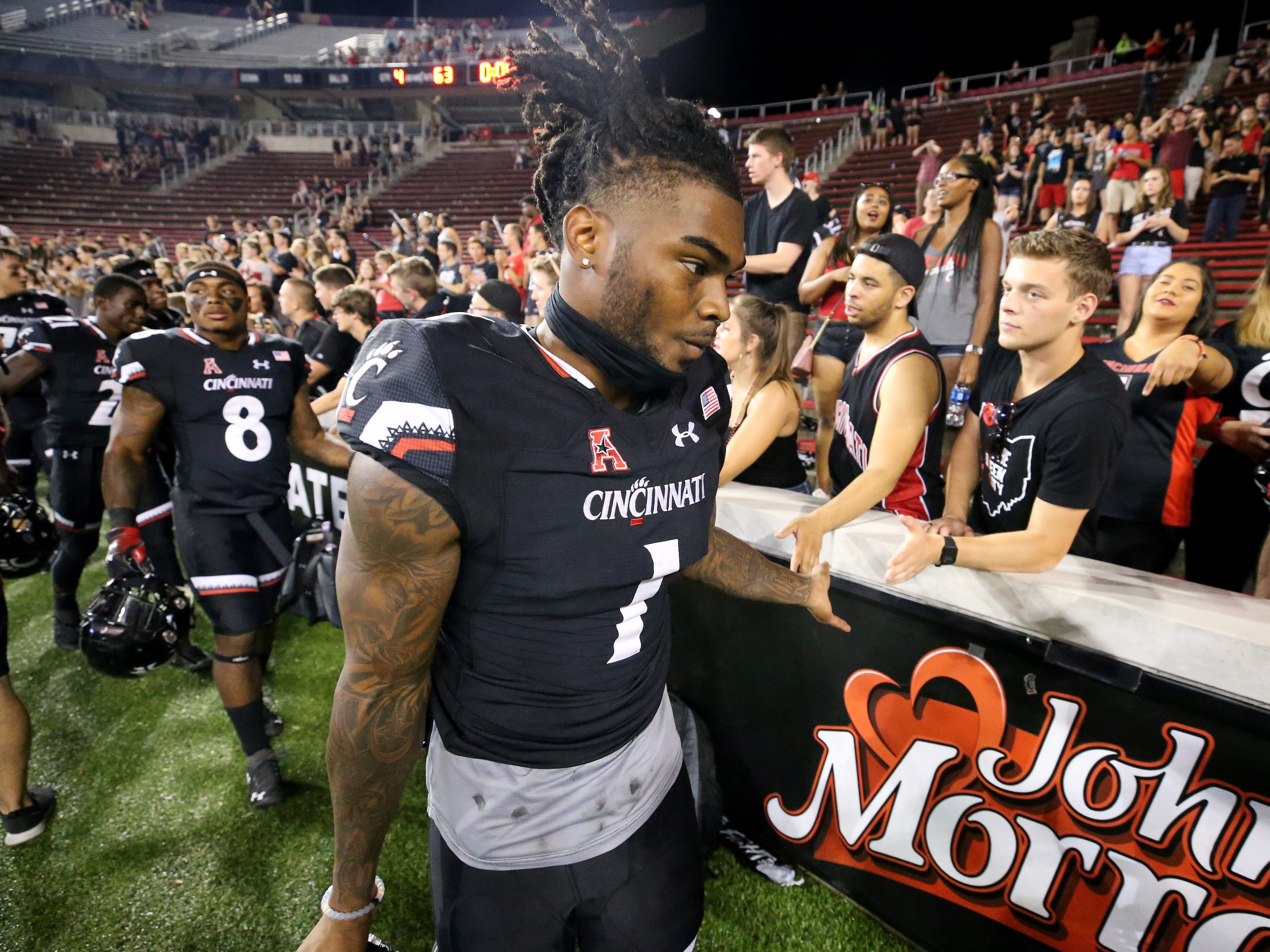 Cincinnati Bearcats wide receiver Kahlil Lewis (1) high fives fans after a college football game between the Cincinnati Bearcats and the Alabama A&M Bulldogs, Saturday, Sept. 15, 2018, at Nippert Stadium in Cincinnati. Cincinnati Bearcats won 63-7.