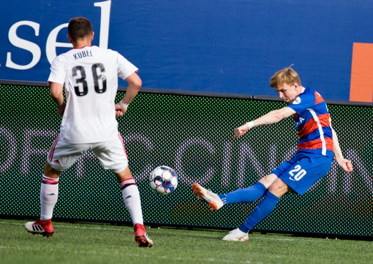 FC Cincinnati midfielder Jimmy McLaughlin (20) hits the ball past Toronto FC defender Tim Kubel (36) during the USL match between FC Cincinnati and Toronto FC on Sunday, Sept. 16, 2018, at Nippert Stadium in Cincinnati.