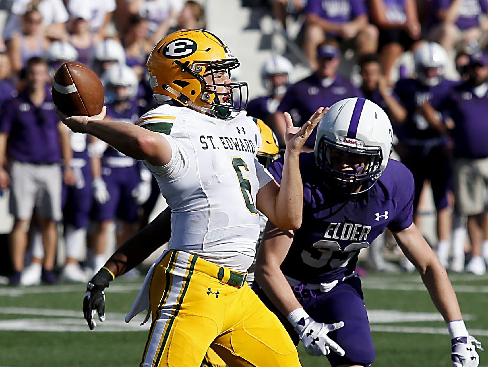 St. Edward quarterback Garrett Dzuro is rushed by Elder linebacker Jake Hofmeyer during their game at The Pit in Cincinnati Saturday, Sept. 15, 2018.