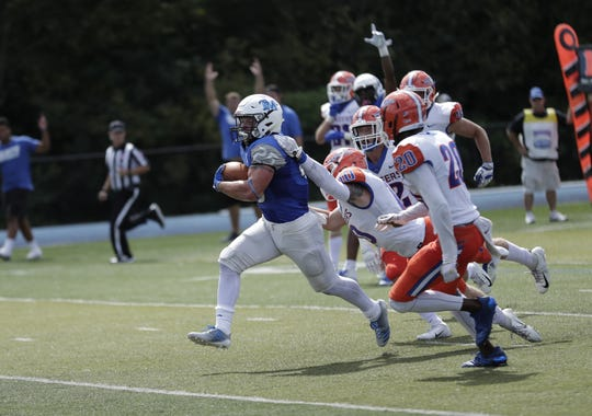 Thomas More College football's Luke Zajac, a graduate of Dixie Heights, takes the ball and runs for a 17-yard touchdown in the 35-28 win over No. 16-ranked Wisconsin-Platteville.