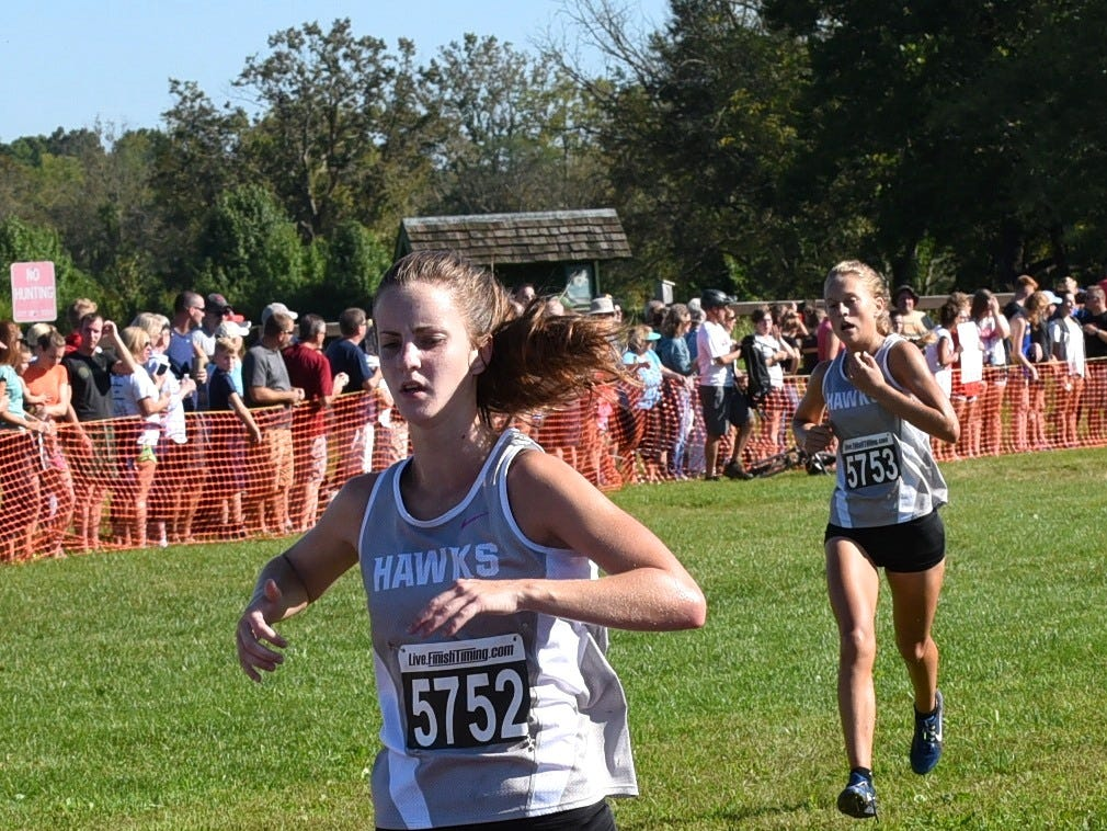 Danielle Horter locked up fourth place in the girls varsity 5K run at the 2018 Milford Cross Country Invitational, Sept. 15, 2018.