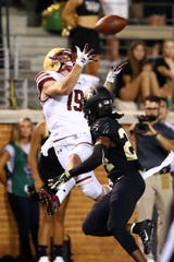 Sep 13, 2018; Winston-Salem, NC, USA; Boston College Eagles wide receiver Ben Glines (19) catches a pass in the fourth quarter against Wake Forest Demon Deacons defensive back Ja'Sir Taylor (24) at BB&T Field.