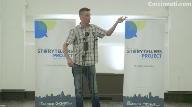 """Rick Wolf tells a story at the Cincy Storyteller's Project """"Away We Go"""" event."""
