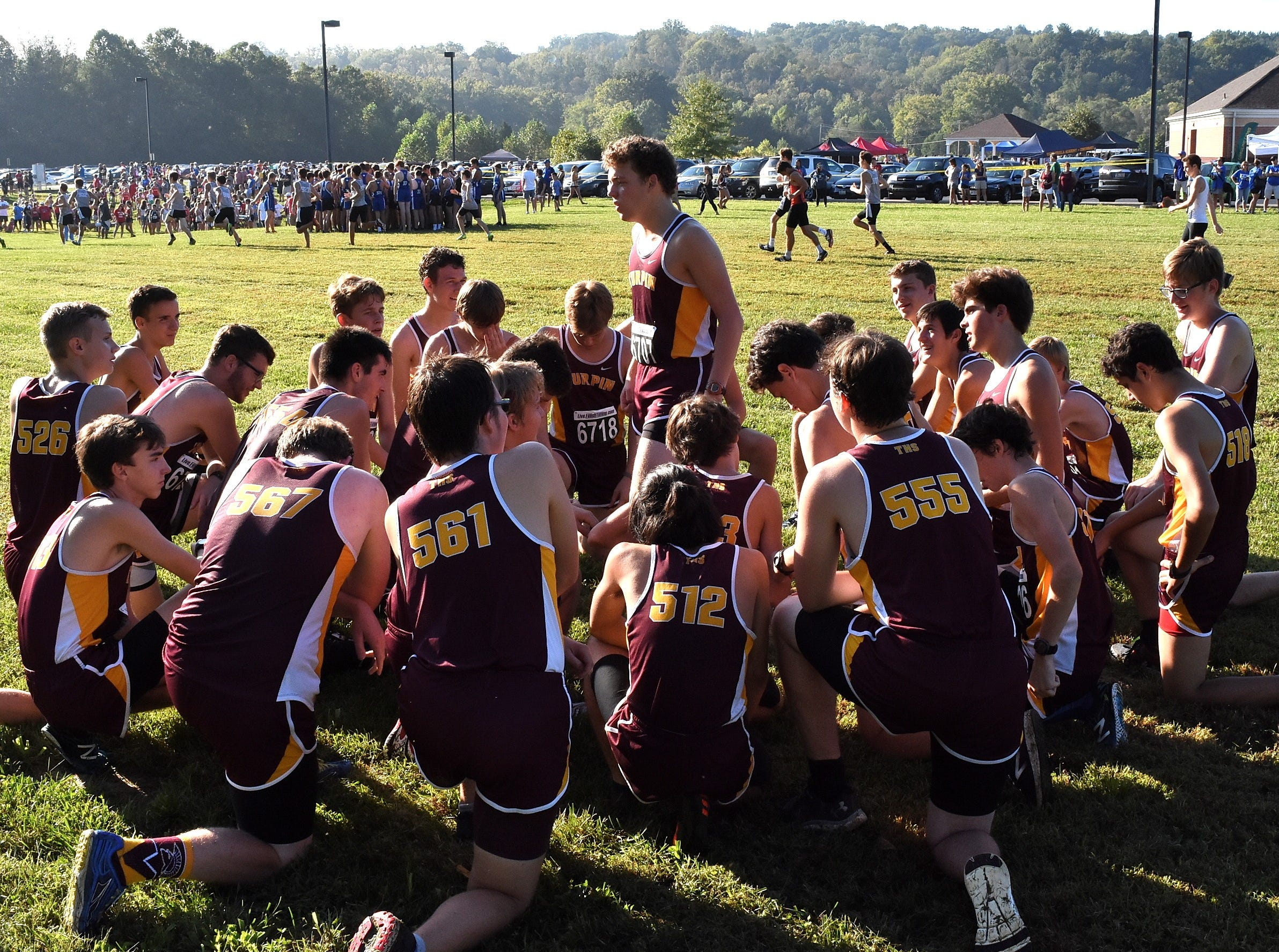 The Turpin runners get hyped and ready to run in the Boys 5K Open at the 2018 Milford Cross Country Invitational, Sept. 15, 2018.
