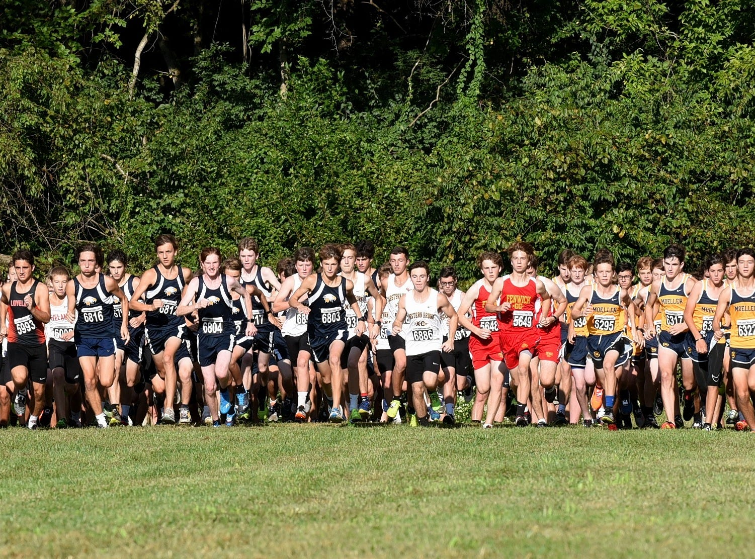 Guys in the Boys 5K Open race take the course at the 2018 Milford Cross Country Invitational, Sept. 15, 2018.