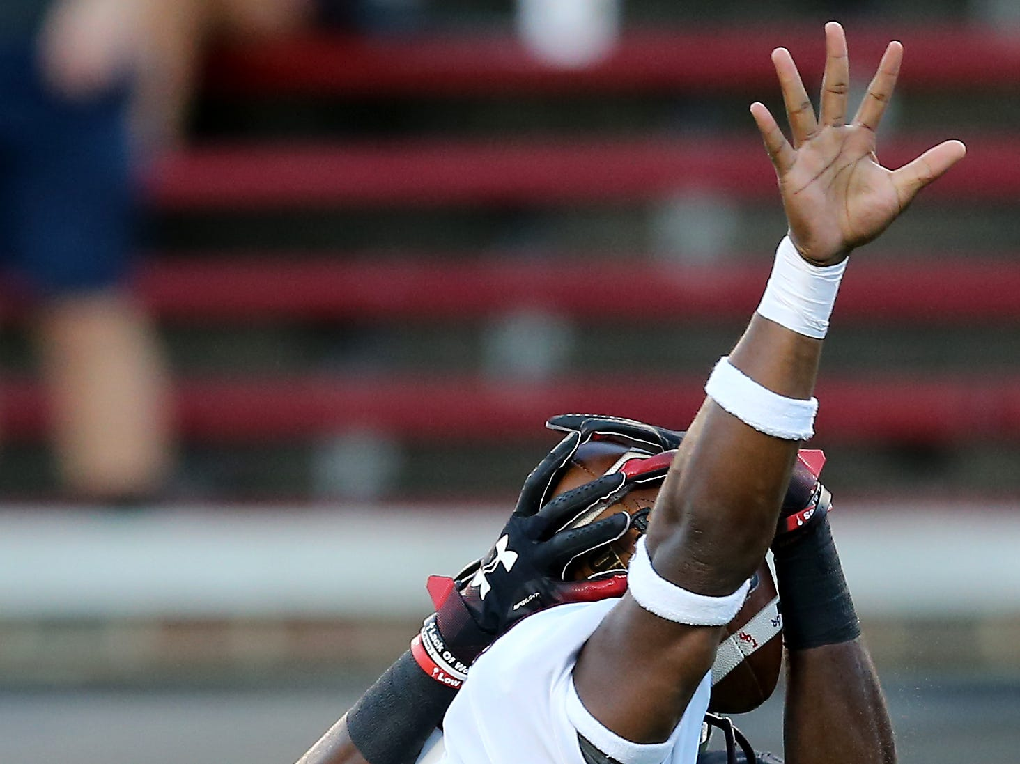 Cincinnati Bearcats wide receiver Thomas Geddis (85) pins the ball on Alabama A&M Bulldogs cornerback Joshua M. Williams (28) to complete a touchdown catch in the first quarter during a college football game between the Cincinnati Bearcats and the Alabama A&M Bulldogs, Saturday, Sept. 15, 2018, at Nippert Stadium in Cincinnati.