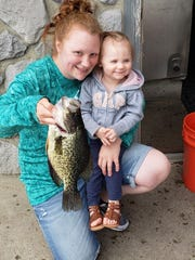 Sabrina Mackin (with her daughter) holds a 1.14-pound crappie they caught at Lake Hopatcong on Sept. 12.