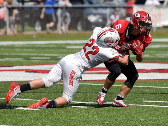 Andrew Kittell, of Coshocton, tackled by Mason Elson duringt the Redskins' 32-0 loss to Port Clinton on Saturday at Stewart Field.