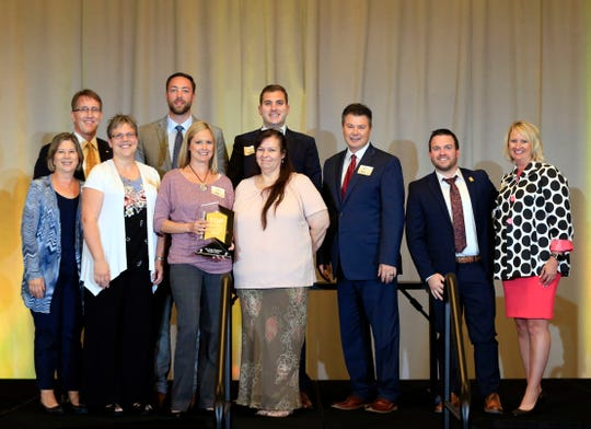 Edward Jones representatives accept the award for top large employer during the Top Workplaces awards in 2018. Edward Jones has participated in Top Workplaces for eight years and has finished in the top ranks each of those years.