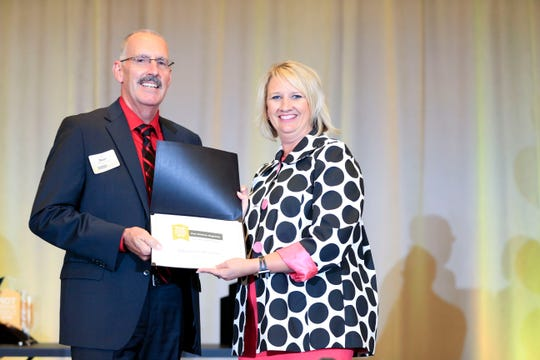 Jim Dean of Affinity Credit Union accepts the benefits award during the Top Workplaces awards in Des Moines Sept. 13, 2018.