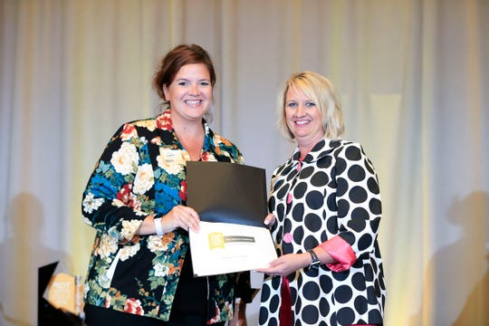 Kate Juelfs of Foster Group accepts the Communication award during the Top Workplaces awards in Des Moines Sept. 13, 2018.
