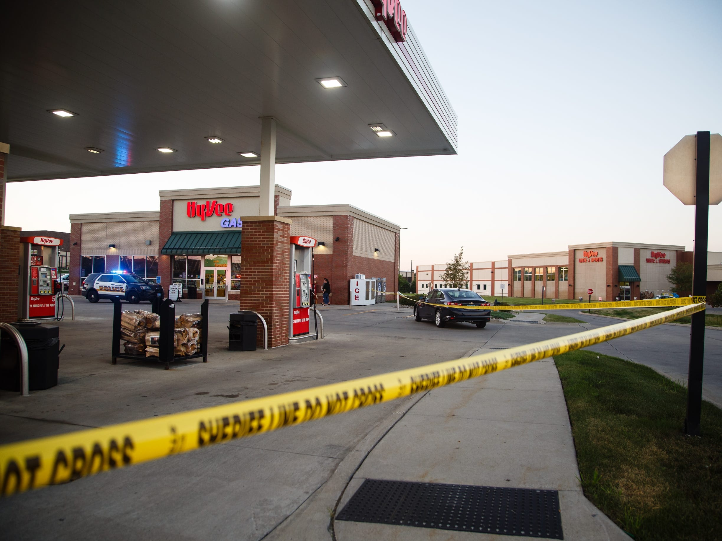 Police investigate the scene of a robbery at the Hy-Vee gas station in the 2500 block of Southwest State Street in Ankeny. The suspect fled across the street where there was an officer involved shooting behind the Kum and Go.
