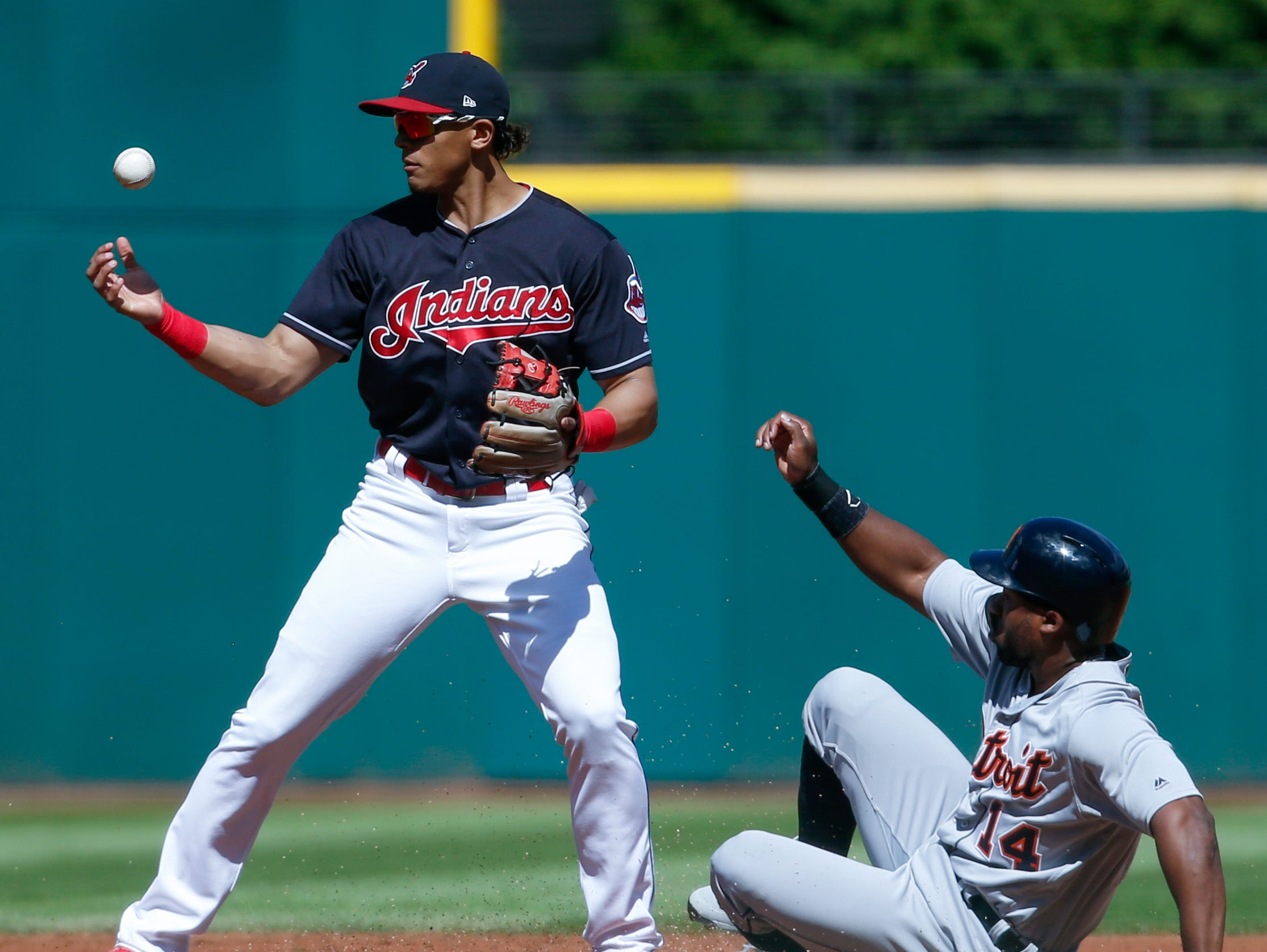 Indians shortstop Erik Gonzalez, left, forces out Tigers left fielder Christin Stewart at second base but then misplays the throw on a ball hit by Nicholas Castellanos during the first inning on Sunday, Sept. 16, 2018, in Cleveland.