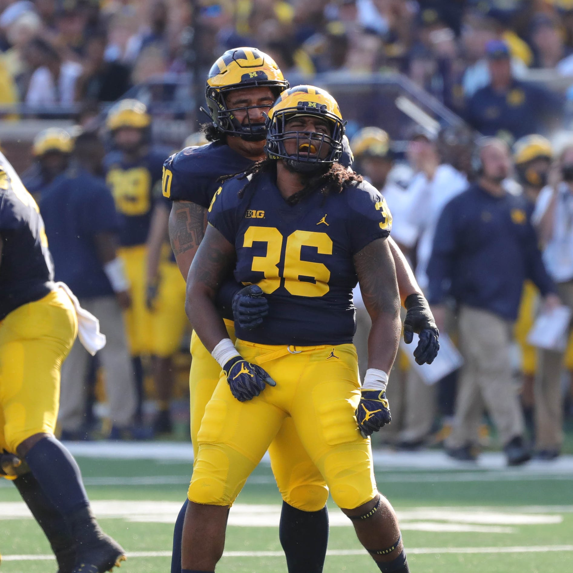 Michigan's Devin Gil (36) celebrates with defensive lineman Bryan Mone against SMU during the first half Saturday, Sept. 15, 2018 at Michigan Stadium.