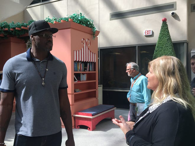 Former Detroit Pistons defensive stalwart Ben Wallace speaks to Beaumont Children's Hospital official Kathleen Grobbel during a visit last month to pediatric patients.
