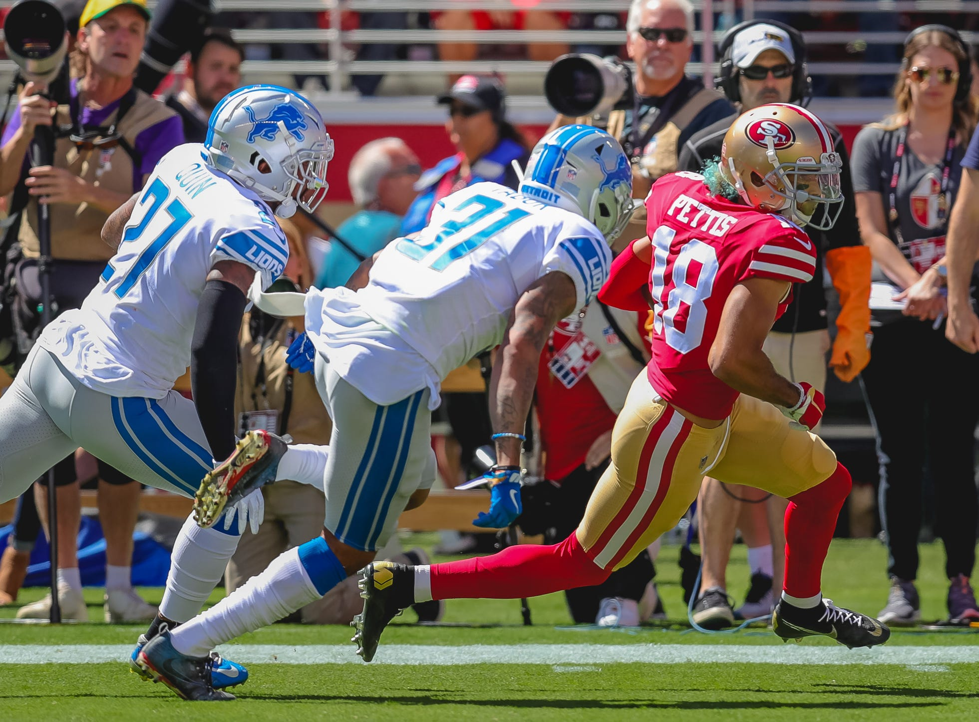 49ers wide receiver Dante Pettis runs past Lions cornerback Teez Tabor, middle, and safety Glover Quin during the first quarter on Sunday, Sept. 16, 2018, in Santa Clara, Calif.