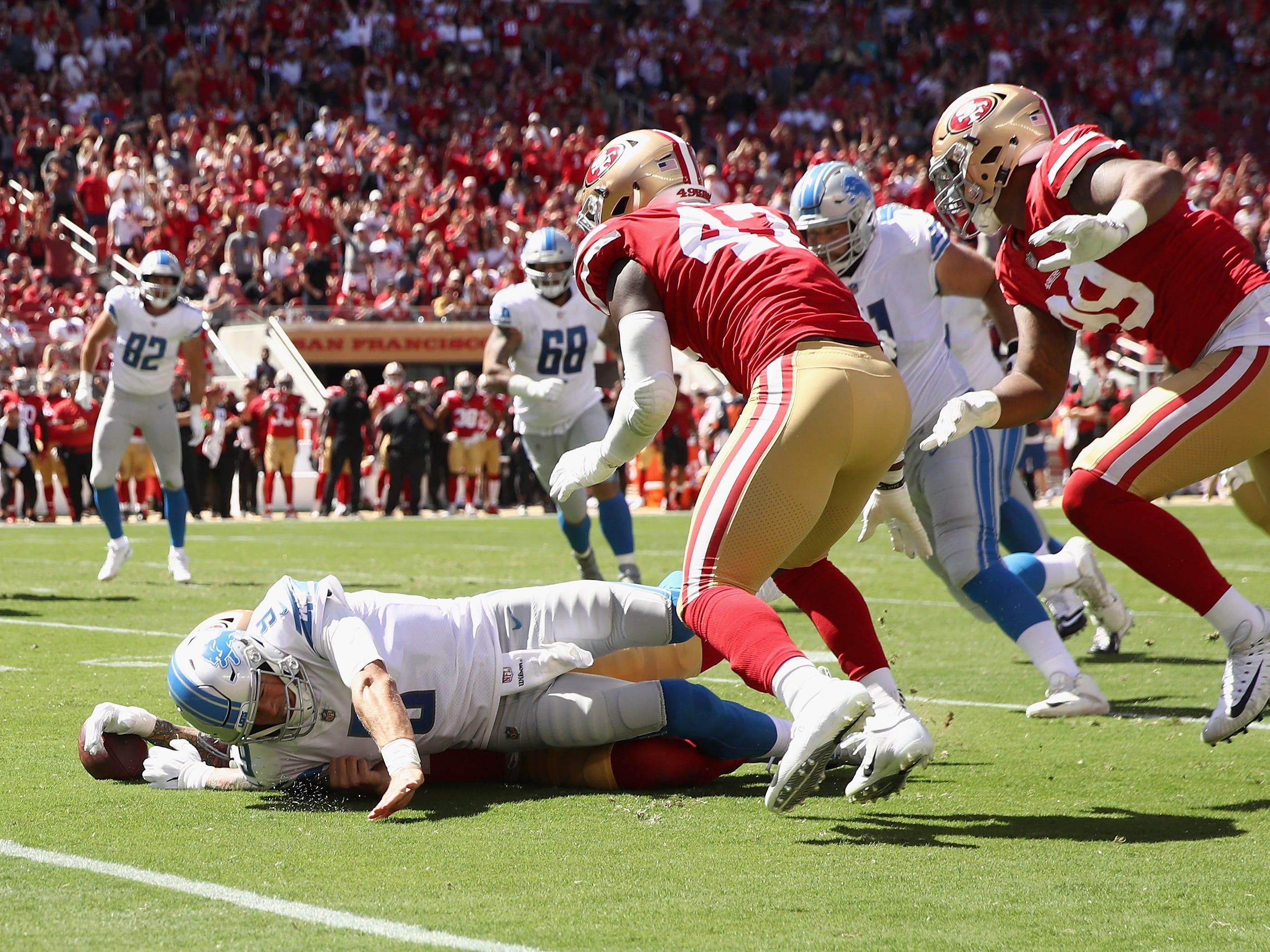 Detroit Lions QB Matthew Stafford fumbles the ball against the San Francisco 49ers at Levi's Stadium on Sept. 16, 2018 in Santa Clara, Calif.