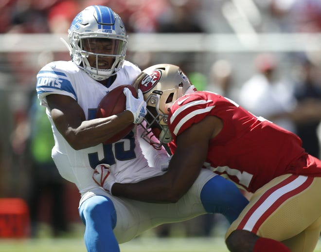 Jamal Agnew is hit on a punt return by the 49ers' Raheem Mostert in the second quarter Sunday.