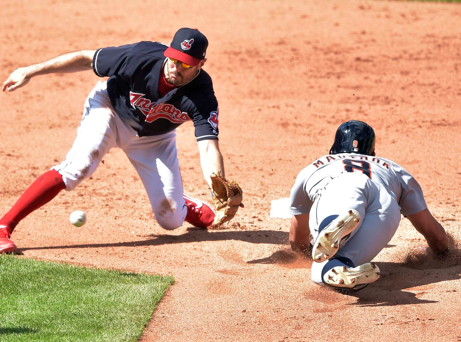 Tigers right fielder Mikie Mahtook steals second base beside Indians second baseman Adam Rosales in the fifth inning of the Tigers' 6-4 win on Sunday, Sept. 16, 2018, in Cleveland.