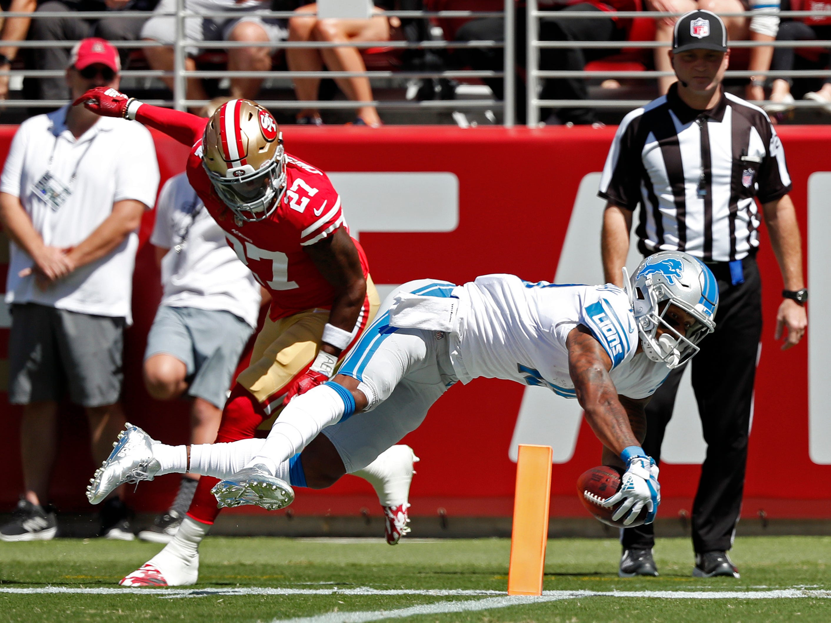Lions receiver Kenny Golladay reaches for the pylon and scores a touchdown past 49ers defensive back Adrian Colbert in the first half Sunday, Sept. 16, 2018, in Santa Clara, Calif.