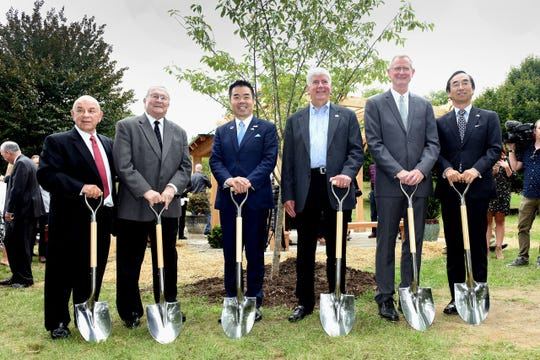 From left: Robert Gatt, Mayor of Novi; L. Brooks Patterson, Oakland County Executive; Taizo Mikazuki, Governor, Shiga Prefecture, Japan; Rick Snyder, Governor, State of Michigan; Dr. Jeff Dwyer, Director, Michigan State University Extension, Novi and Mitsuhiro Wada, Consul General of Japan. A cherry tree  was planted at Japanese Garden at Meijer Gardens to commemorate the anniversary of the sister-state relationship between Shiga Prefecture, Japan, and Michigan 50 years ago.
