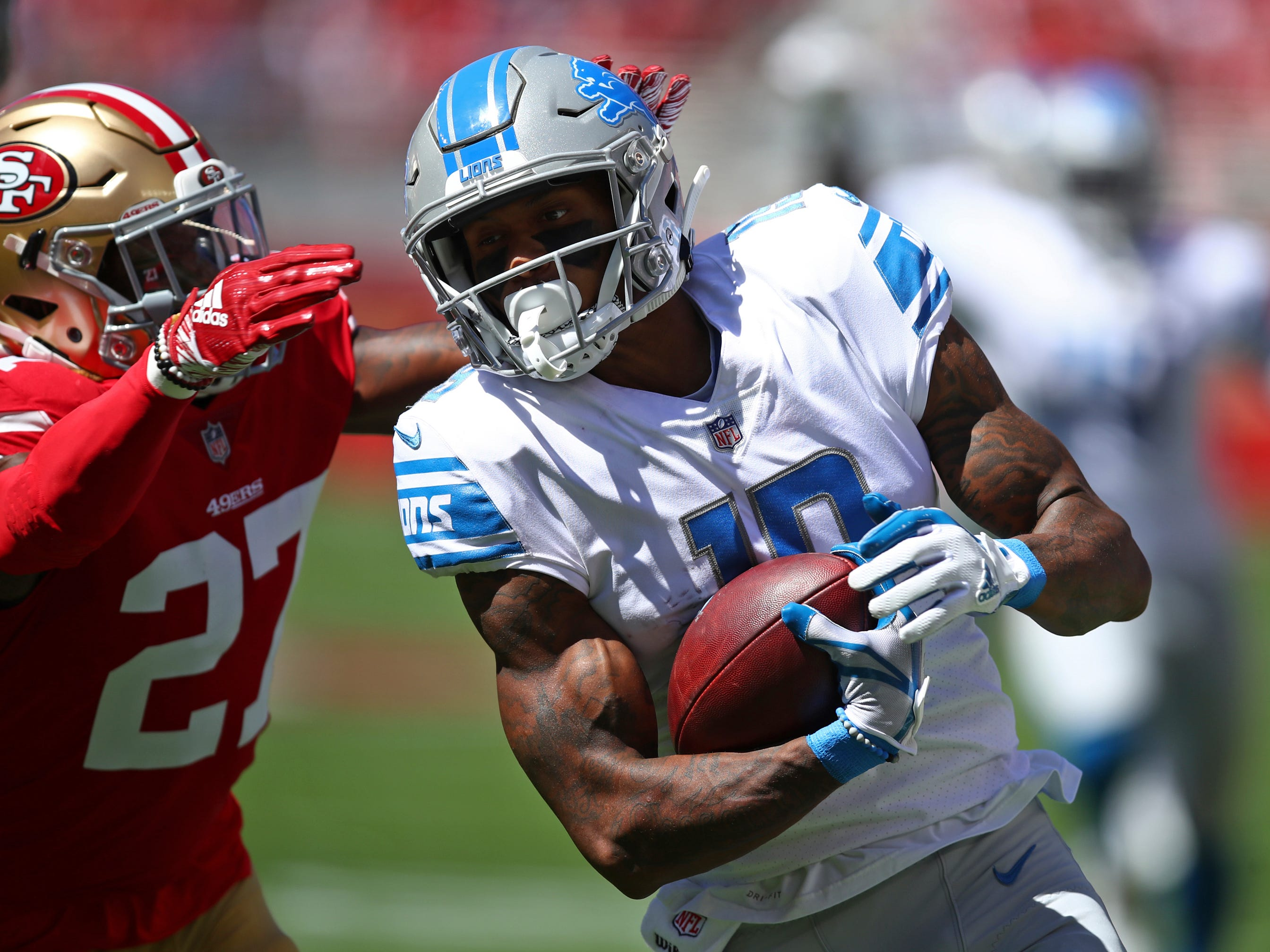 Lions receiver Kenny Golladay runs with the ball as 49ers defensive back Adrian Colbert pursues during the first half Sunday, Sept. 16, 2018, in Santa Clara, Calif.