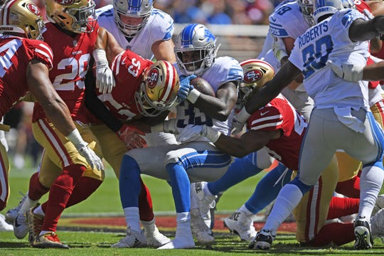 Kerryon Johnson is tackled in the first quarter against the 49ers.