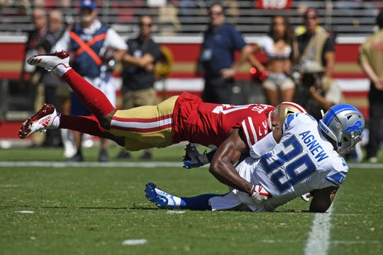San Francisco 49ers' Raheem Mostert tackles Detroit Lions' Jamal Agnew in the second quarter Sunday, Sept. 16, 2018 at Levi's Stadium in Santa Clara, Calif.
