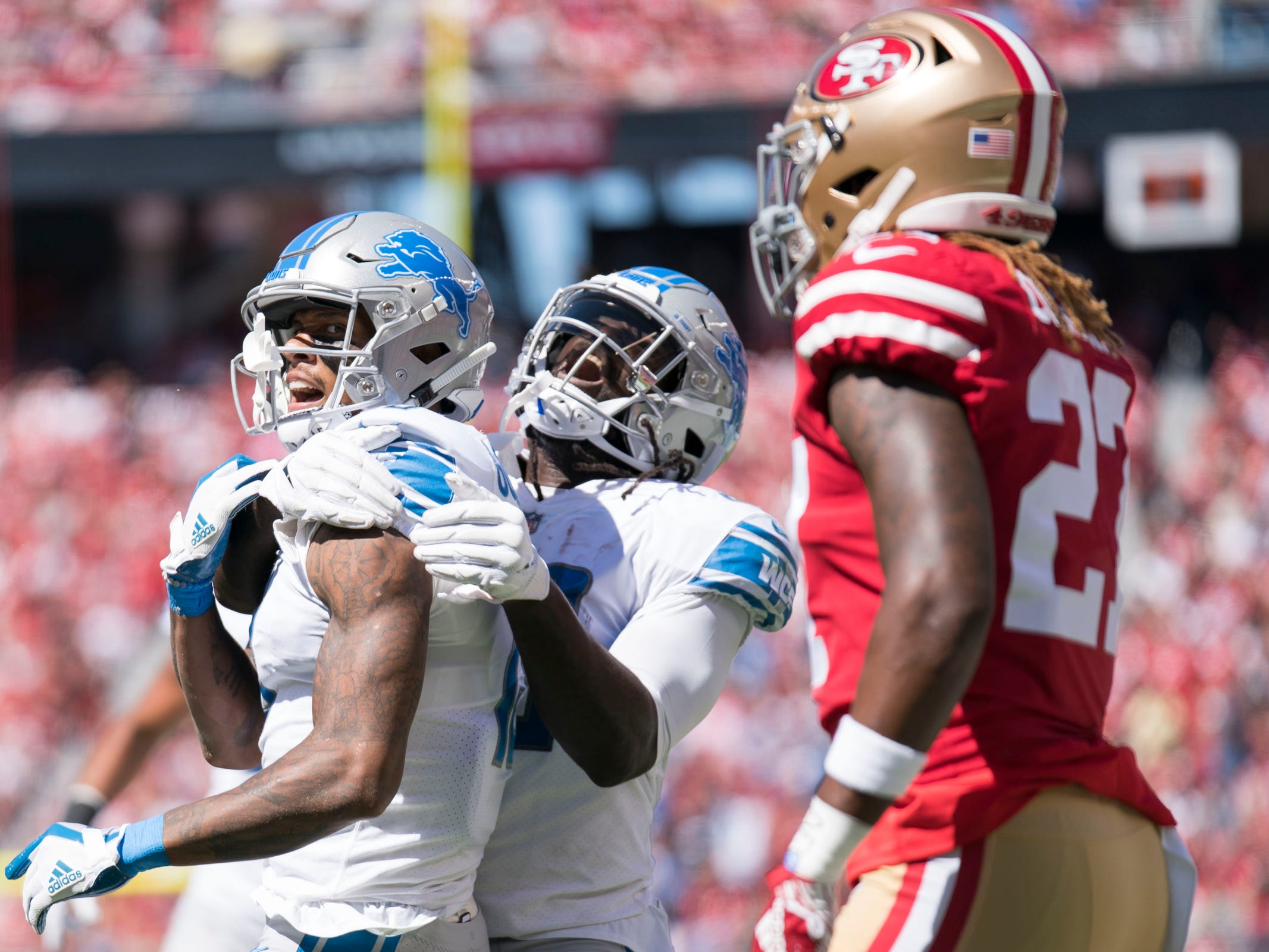 Lions wide receiver Kenny Golladay, left, is congratulated by running back LeGarrette Blount for scoring a touchdown as 49ers defensive back Adrian Colbert looks on during the first quarter on Sunday, Sept. 16, 2018, in Santa Clara, Calif.