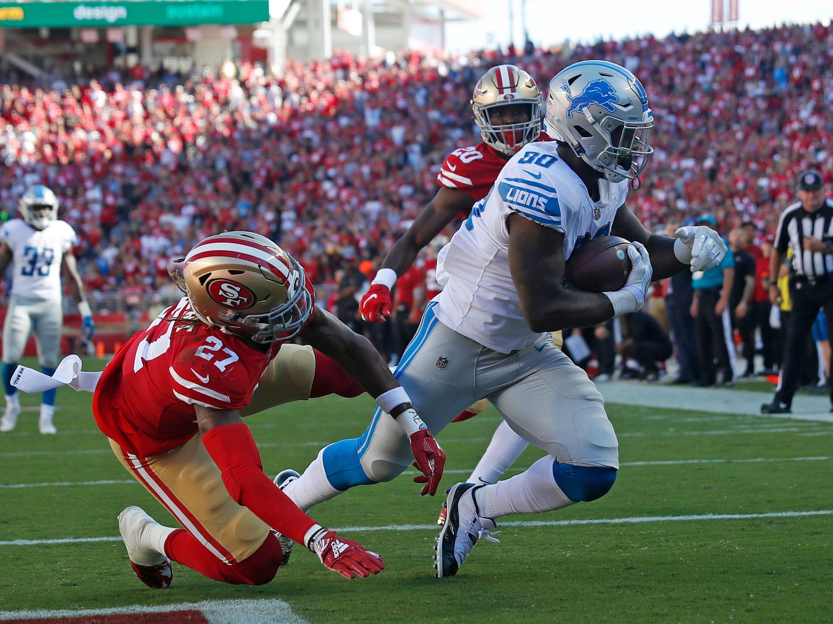 Detroit Lions tight end Michael Roberts scores a touchdown against San Francisco 49ers defensive back Adrian Colbert in the fourth quarter in Santa Clara, Calif., Sunday, Sept. 16, 2018.
