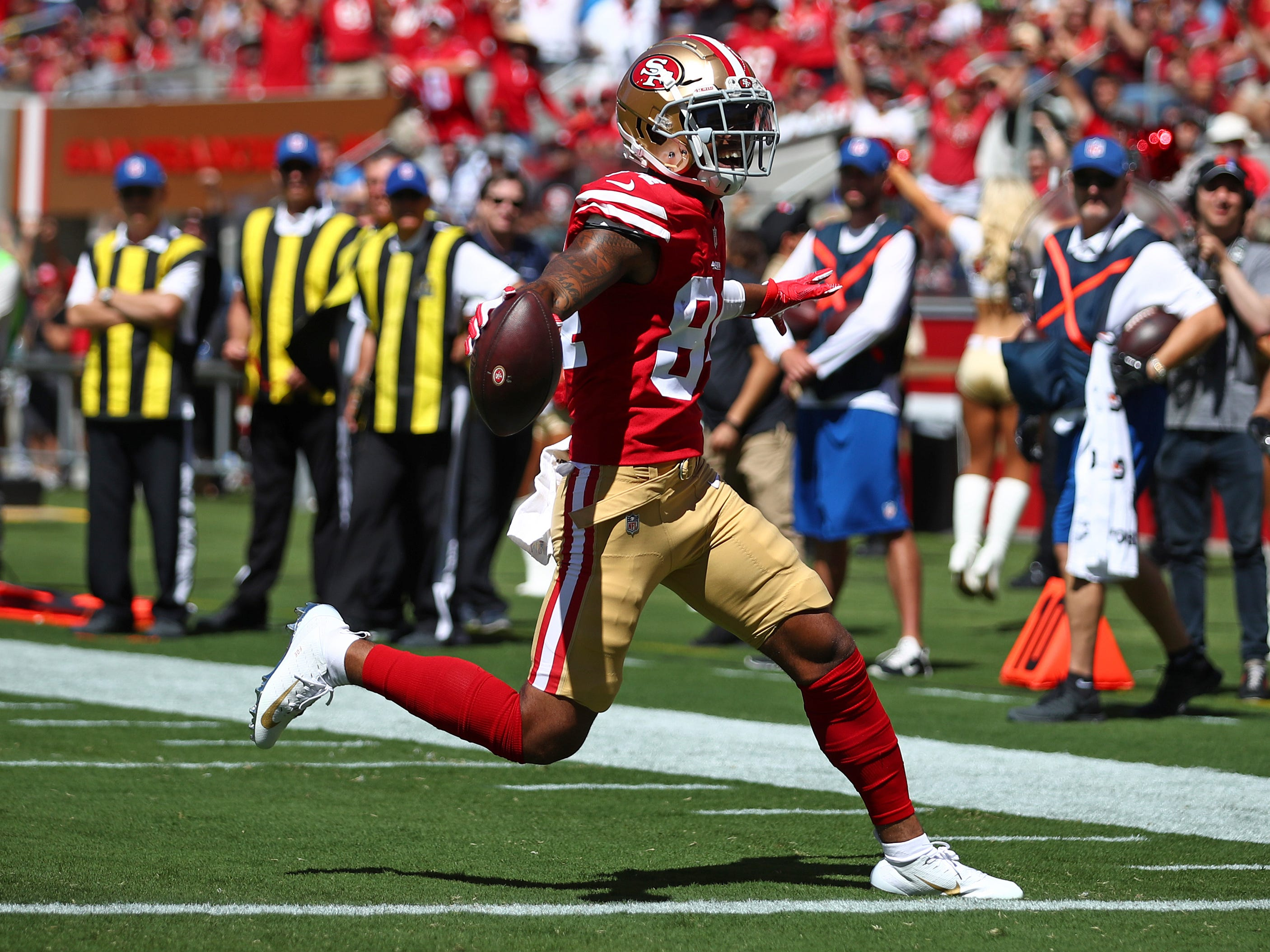 49ers wide receiver Kendrick Bourne carries the ball into the end zone for a touchdown during the first half on Sunday, Sept. 16, 2018, in Santa Clara, Calif.