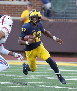 Michigan running back Chris Evans runs against SMU during the second half Saturday, Sept. 15, 2018 at Michigan Stadium.