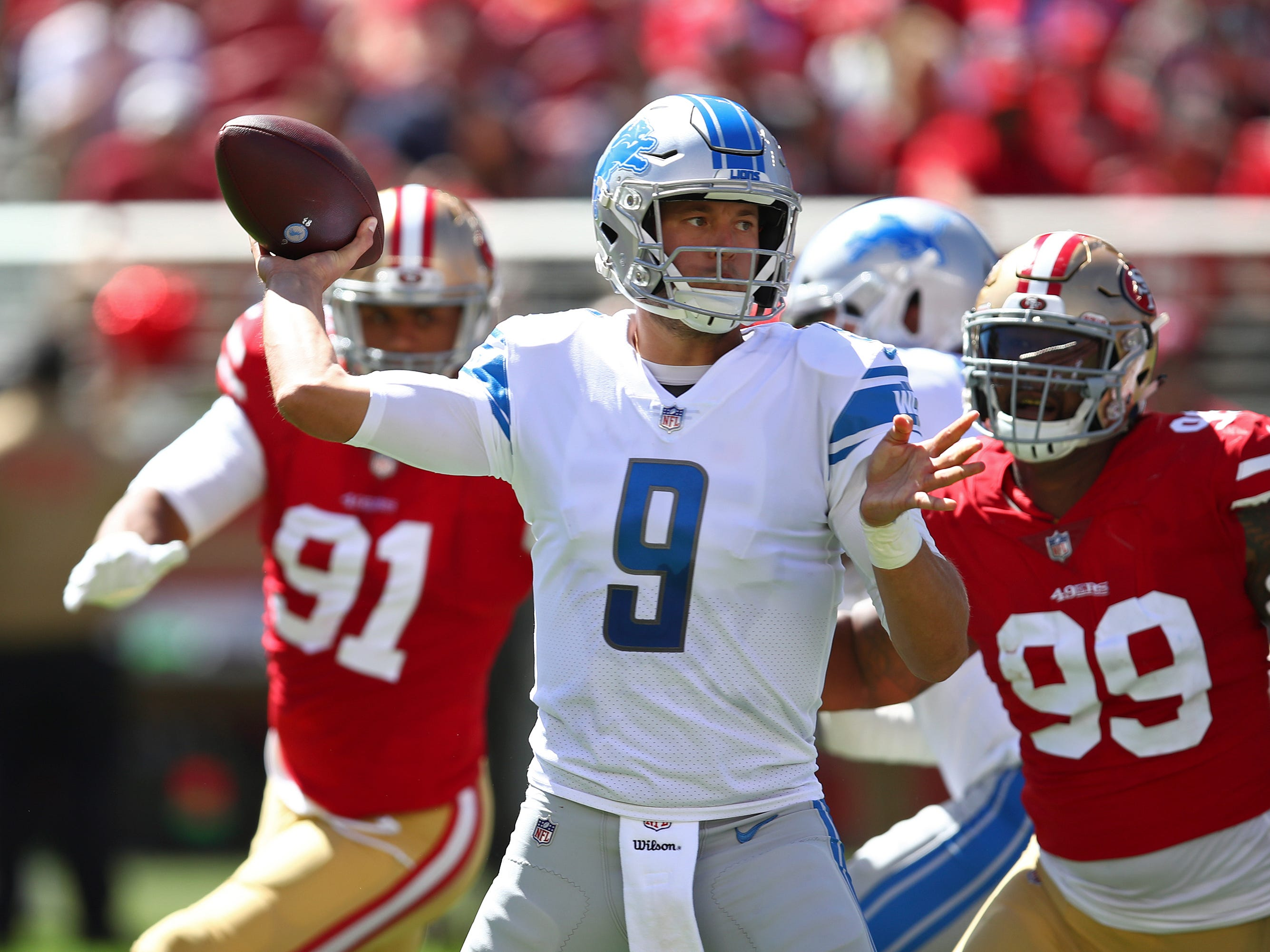 Lions quarterback Matthew Stafford looks to throw as 49ers defensive end DeForest Buckner (99) applies pressure during the first half Sunday, Sept. 16, 2018, in Santa Clara, Calif.